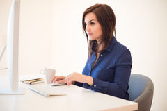 Woman on desk Royalty Free Stock Photography