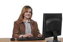 Woman on desktop computer Royalty Free Stock Image