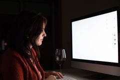 Woman on desktop Stock Image