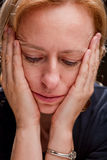 Woman in despair. With her head in her hands Royalty Free Stock Photo