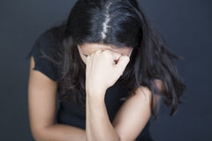 Woman desperate. Dark-haired woman desperate on black background Royalty Free Stock Images