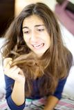 Woman desperate about her terrible destroyed hair Stock Image
