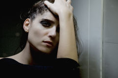 Woman desperate and sad in front of mirror in bathroom with wet hair closeup Royalty Free Stock Photography