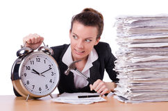 Woman desperate with time hitting clock Royalty Free Stock Photos