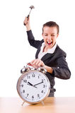 Woman desperate with time hitting clock Royalty Free Stock Photo