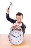 Woman desperate with time hitting clock Royalty Free Stock Image