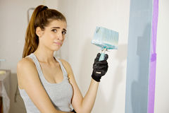 Woman desperate and tired about painting home Stock Image