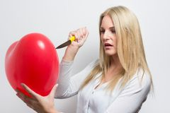 Woman destroying heart Stock Image