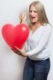 Woman destroying heart after breakup Royalty Free Stock Images