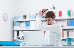 Woman destroying her laptop royalty free stock photo