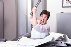 Woman is destroying her PC - overworked Stock Images