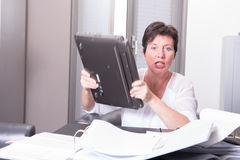Woman is destroying her PC - overworked Stock Photo