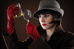 Woman detective examines. The evidence stock photos