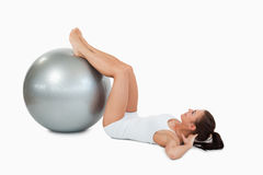 Woman developing  her abs with a ball Stock Photography