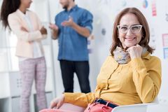 Woman developing her career. Photo of mature women developing her career in company Royalty Free Stock Photo