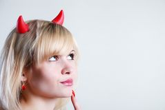 Woman devil. Thinking at white background stock photo