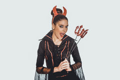Woman in devil carnival costume. Royalty Free Stock Photography