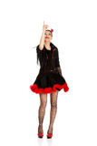Woman in devil carnival costume pointing up. Royalty Free Stock Photo
