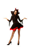 Woman in devil clothes with open hands gesture Royalty Free Stock Image