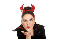 Woman in devil costume blowing a kiss. Stock Photos