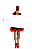 Woman in devil costume with empty banner. Stock Photos