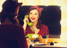 Woman with dial phone applying cosmetics Stock Image