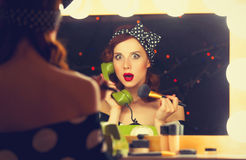 Woman with dial phone applying cosmetics Stock Photography
