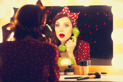 Woman with dial phone applying cosmetics Royalty Free Stock Photos