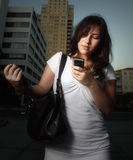 Woman dialing a cell phone Stock Image