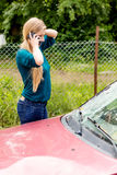 Woman dialing her phone after car crash Royalty Free Stock Photo