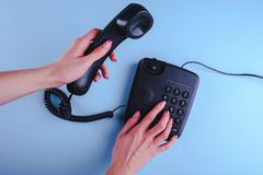 Woman dialing a number on old fashioned phone. Close up stock image