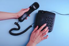Woman dialing a number on old fashioned phone. Close up stock photo