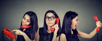 Woman Dialing Number On Vintage Telephone Curiously Listening And Getting Angry Screaming On The Phone Royalty Free Stock Images
