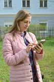 The woman dials the phone number on the smartphone.  royalty free stock images