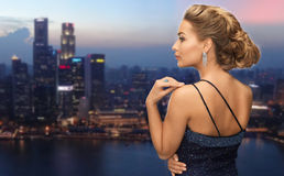 Woman with diamond earring over night city Royalty Free Stock Photos