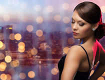 Woman with diamond earring over night city Royalty Free Stock Image