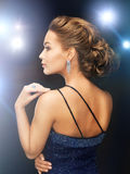 Woman with diamond earrings Royalty Free Stock Photography