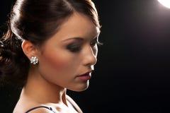 Woman with diamond earrings stock photo