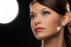 Woman with diamond earrings Stock Image