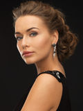 Woman with diamond earrings Stock Photography