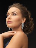 Woman with diamond earrings Stock Photo