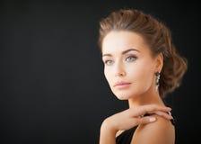 Woman with diamond earrings. Beautiful woman in evening dress wearing diamond earrings Royalty Free Stock Photo