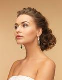 Woman with diamond earrings Stock Photos