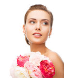Woman with diamond earrings and flowers Royalty Free Stock Photos