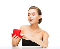 Woman with diamond earrings and gift box Stock Images