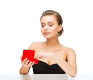 Woman with diamond earrings and gift box Stock Photography