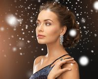 Woman with diamond earrings Stock Images