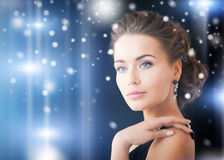 Woman with diamond earrings Royalty Free Stock Photo