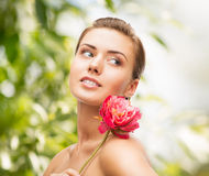 Woman with diamond earrings, ring and flower Stock Photos