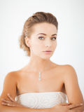 Woman with diamond necklace Stock Photography